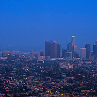Downtown Los Angeles, California, glows in the dusk of a smoggy day, viewed from Griffith Park Observatory.