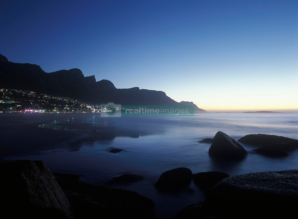 Looking along the 12 Apostles and down the Cape peninsula as seen from Camps Bay at dusk, Cape Town, South Africa. (Credit Image: © Axiom/ZUMApress.com)