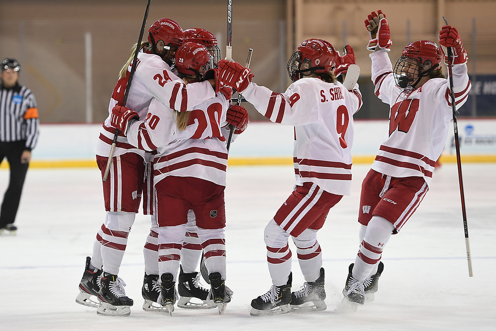 ERIE, PA - MARCH 16: Brette Pettet #20 of the Wisconsin Badgers celebrates with teammates after scoring a goal in the first period during the NCAA Tournament Quarterfinals game against the Providence Friars at the Erie Insurance Arena on March 16, 2021 in Erie, Pennsylvania. (Photo by Justin Berl)