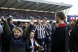 18 February 2017 - FA Cup, Fifth Round - Millwall v Leicester City<br /> Millwall fans celebrate with Shaun Williams of Millwall after their victory<br /> Photo: Charlotte Wilson