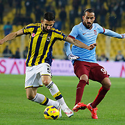 Fenerbahce's Mehmet Topal (L) and Trabzonspor's Erkan Zengin (R) during their Turkish superleague soccer derby Fenerbahce between Trabzonspor at the Sukru Saracaoglu stadium in Istanbul Turkey on Saturday 07 February 2015. Photo by Aykut AKICI/TURKPIX