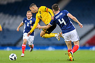 Eden Hazard (#10) of Belgium is pulled back by John Souttar (#4) of Scotland during the International Friendly match between Scotland and Belgium at Hampden Park, Glasgow, United Kingdom on 7 September 2018.