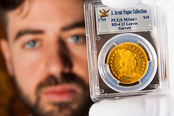 London, March13th 2015. Ahead of the first sale of the D. Brent Pogue rare United States Federal coin  collection sale to be held at Sotheby's  New York. The collection is composed of over 650 gold, silver, and copper coins, and is expected to be the most valuable collection of coins ever sold. PICTURED: A 1795 Eagle Ten Dollar coin, one of the most perfectly preserved examples, which is expected to fetch up to $10 million at auction.