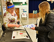 Election judge Danielle Wilburn (left) checks the ballot of voter Katherine Brabenec before Brabenec slides it into the ballot box at Douglas School in Belleville, polling place for precincts 24 and 25 on Tuesday, November 3, 2020.  <br /> Photo by Tim Vizer