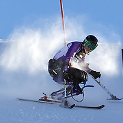 Peter Dunning, Great Britain, in action during his third place finish in the Men's Slalom Sitting, Adaptive Slalom competition at Coronet Peak, New Zealand during the Winter Games. Dunning, who lost both his legs in a roadside bombing attack in Afghanistan three years ago. Winter Games, Queenstown, New Zealand, 25th August 2011. Photo Tim Clayton