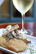 Crab Ravigote over fired green tomatoes, with Albarino wine from the Parejas Dutchman Vineyard, Yakima Valley. <br /> John Lok / The Seattle Times