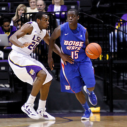 December 10, 2011; Baton Rouge, LA; Boise State Broncos forward Thomas Bropleh (15) is guarded by LSU Tigers forward Storm Warren (24) during the first half of a game at the Pete Maravich Assembly Center.  Mandatory Credit: Derick E. Hingle-US PRESSWIRE