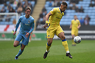 Bristol Rovers forward Johnson Clarke-Harris (19) battles for possession  with Coventry City defender Tom Davies  (5) during the EFL Sky Bet League 1 match between Coventry City and Bristol Rovers at the Ricoh Arena, Coventry, England on 7 April 2019.