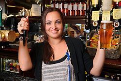 © Licensed to London News Pictures. 05/10/2011 London, UK. X Factor finalist Sophie Habibis pulls a final pint at The Whittington Stone pub in Archway, London where she worked before entering the competition. Sophie, 19 was revealed as one of judge Kelly Rowland's final four contestants who will compete in the live finals. Photo credit : Simon Jacobs/LNP