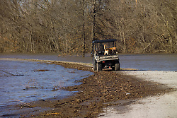 Road just North of The Bush Creek Marsh Arch Rainbow Bridge on Old Route 66 Riverton, KS. Flooded by a 100 Year Flood on 20 March 2008. View of roadway underwater, approx view southwest, north of the bridge. John North, local resident and bridge keeper, on Gator with his Lab checking out the scene.