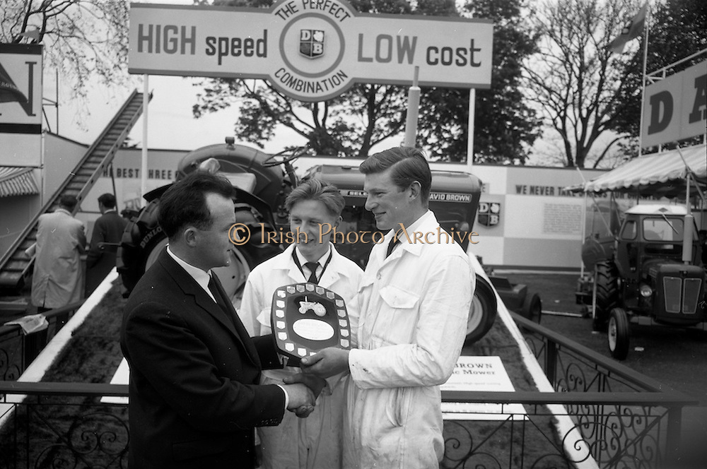 06/05/1965<br /> 05/06/1965<br /> 06 May 1965<br /> Final of the 4th Annual David Brown Tractor and Implement Maintenance Competition held at the RDS Spring Show, Ballsbridge, Dublin.  Mr. V.K. Bell, General Manager, David Brown (Ireland) Ltd. presenting the trophy to winner John Kehoe of Tincurry, Ferns, Co. Wexford and his helper, John Denby (centre) of Castlelands. The winner and his helper would receive special educational scholarships to the David Brown Farm Machinery Service School in Meltham, Yorkshire, England.