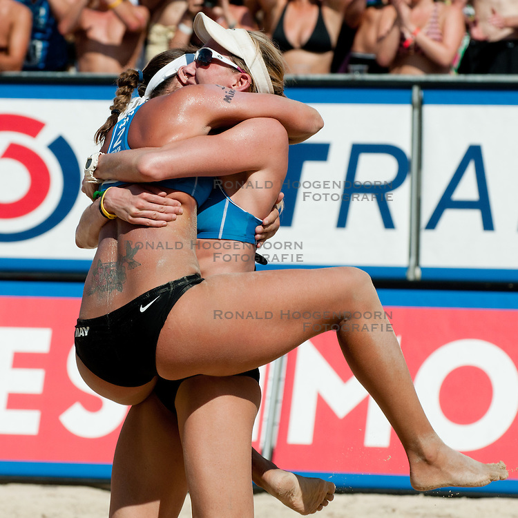 06-08-2011 VOLLEYBAL: FIVB WORLD TOUR GRANDSLAM: KLAGENFURT<br /> Kerri Walsh and Misty May-Treanor of USA celebrate victory of A1 Beach Volleyball Grand Slam tournament of Swatch FIVB World Tour 2011<br /> ©2011-FotoHoogendoorn.nl / Matic Klansek Velej