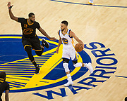 Cleveland Cavaliers center Tristan Thompson (13) defends Golden State Warriors guard Stephen Curry (30) as he dribbles down the court during Game 5 of the NBA Finals at Oracle Arena in Oakland, Calif., on June 12, 2017. (Stan Olszewski/Special to S.F. Examiner)