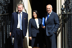 Downing Street, London, May 12th 2015. The all-conservatives Cabinet ministers gather for their first official meeting at Downing Street. PICTURED: Secretary of State for Justice Michael Gove, left, Minister of State for Employment Priti Patel and Secretary of State for Work and Pensions Iain Duncan-Smith.