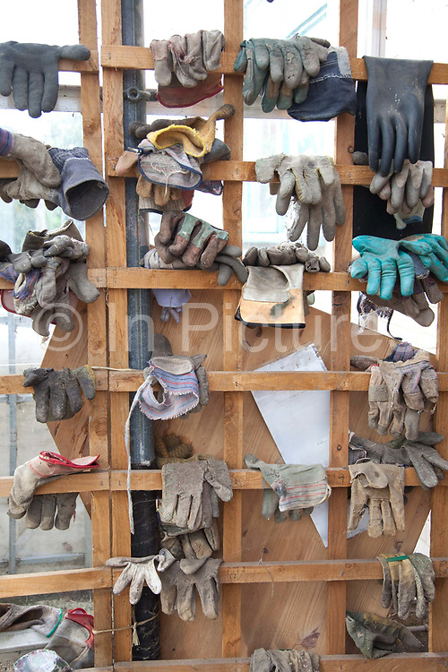 Gloves hanging at Organiclea urban farm. Organiclea in Chingford, Waltham forest east London is one of London's most important urban farms. They run an organic veg box delivery scheme and the Hornbeam cafe.