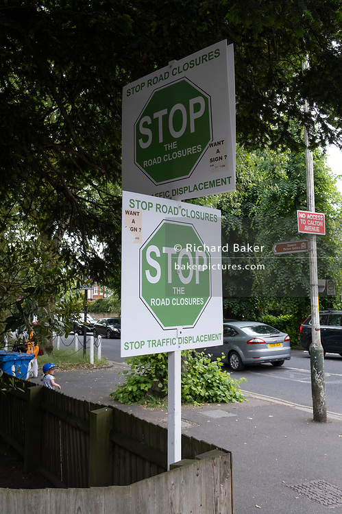 Placards expressing the feelings of residents against local road closures where restrictions during morning and afternoon rush-hour times, prevent traffic to pass through Dulwich Village, on 14th June 2021, in London, England.
