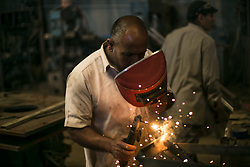 May 1, 2019 - Misrata, Libya - A worker manufactures a weapon to be provided to the Tripoli front-line troops loyal to the UN-backed Libyan government at a local factory in Misrata, Libya, May 1, 2019. A total of 376 people have been killed and 1,822 others injured in the fighting between the UN-backed Libyan government and the east-based army in and around the capital Tripoli so far, the World Health Organization (WHO) said Wednesday. (Credit Image: © Amru Salahuddien/Xinhua via ZUMA Wire)