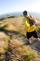 Jason Reale running near the California Coastal Trail; Golden Gate National Recreation Area. San Francisco,  CA<br />