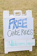 Sign advertising free canoe rides from Wilderness Inquiry outdoor adventure. Aquatennial Beach Bash Minneapolis Minnesota USA