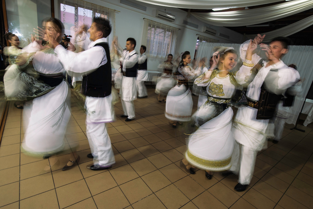 Local folk dancers at the bison release party, at the release of European bison, Bison bonasus, in the Tarcu mountains nature reserve, Natura 2000 area, Southern Carpathians, Romania. The release was actioned by Rewilding Europe and WWF Romania in May 2014.