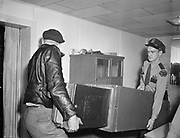 Y-480923-03.  Slot machine raid. Detective Mike Elliot. 3 Star Tavern, 8343 SW Barbur Blvd (now site of the Boom Boom Room) September 23, 1948