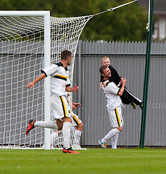 Dumbarton's Bryan Prunty cele scoring their goal with a ball boy.<br /> Dumbarton 1 v 1 Falkirk, Scottish Championship 10/8/2013.<br /> ©Michael Schofield.