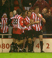 Photo. Glyn Thomas.<br /> Sunderland v Birmingham. FA Cup fifth round.<br /> Stadium of Light, Sunderland. 14/02/2004.<br /> Sunderland's Kevin Kyle (R) is congratulated by teammates after putting his side level.