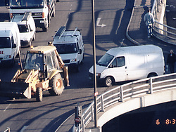 Metropolitan Police surveillance photograph of robbers driving a mechanical excavator and a Transit van to the Millennium Dome November 2000, for an abortive raid on diamonds on display.    * Four men were found guilty by a jury at the Old Bailey in London of plotting to carry out the robbery of the millennium. A fifth man was cleared of conspiracy to rob but found guilty of conspiracy to steal the diamonds