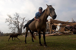 25 Sept, 2005. Cameron, Louisiana. Hurricane Rita aftermath. <br /> Local man Aaron Stokes befriends a horse cut loose ahead of the storm.<br /> Photo; ©Charlie Varley/varleypix.com