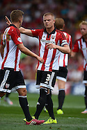 Jake Bidwell, the Brentford captain © gives directions to Konstantin Kerschbaumer of Brentford. Skybet football league Championship match, Brentford v Ipswich Town at Griffin Park in London on Saturday 8th August 2015.<br /> pic by John Patrick Fletcher, Andrew Orchard sports photography.