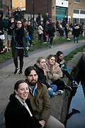 Crowds gather to listen to a busker playing on Regents Canal during the second coronavirus national lockdown on November 7th 2020 Hackney, East London, United Kingdom. The busker playing on the roof top of a canal boat drew a large crowd enjoying his music in-spite of current social distance rules. The UK Government introduced a 4 week lockdown from November 5th - December 2nd to combat the coronavirus outbreak. It is the third day of the national lockdown and restrictions mean that people are only allowed to meet outside, in pairs and only if keeping social distance. Only if they already live together or have formed a social bubble can they interact freely.