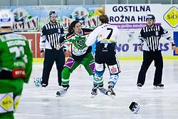 Fight between Brad Cole (HDD Tilia Olimpija, #2) and Brian Lebler (EHC Liwest Linz, #7) during ice-hockey match between HDD Tilia Olimpija and EHC Liwest Black Wings Linz in 51st Round of EBEL league, on Februar 5, 2012 at Hala Tivoli, Ljubljana, Slovenia. (Photo By Matic Klansek Velej / Sportida)