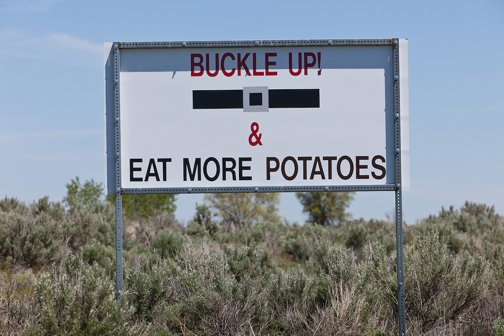 Licensing - Open Edition Prints<br /> Flip side of welcome sign to the Historical town of Pingree along the Snake River near American Falls Reservoir in Southeastern Idaho would like you to buckle up and eat more potatoes
