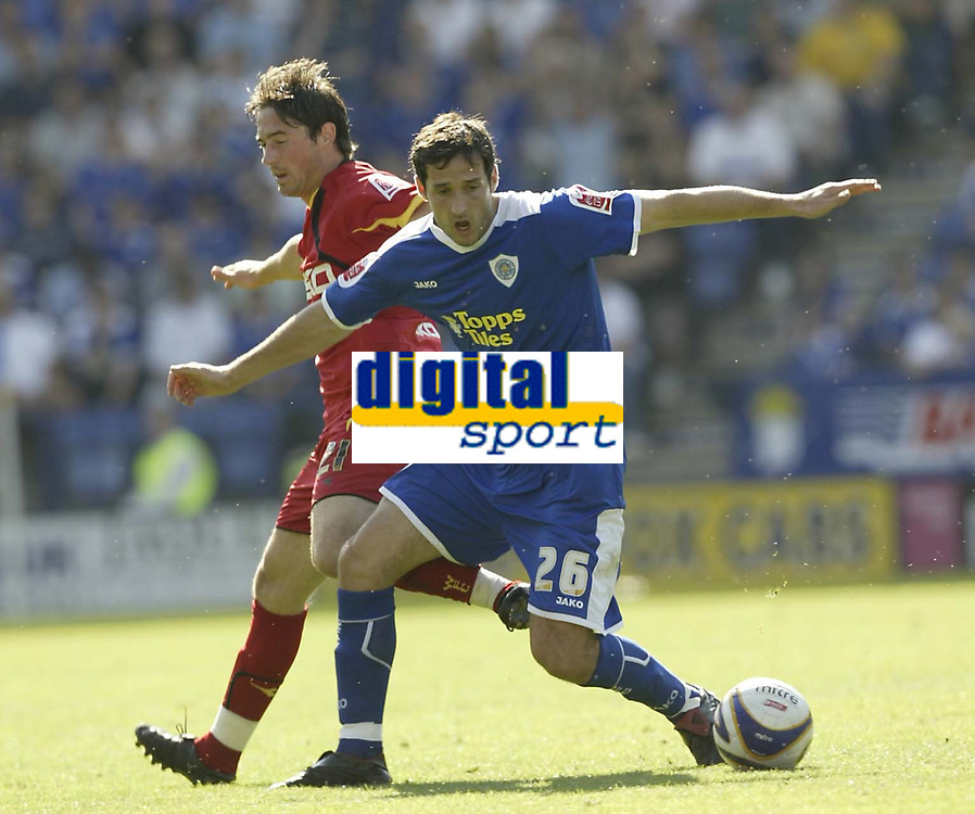 Photo: Aidan Ellis.<br /> Leicester City v Watford. Coca Cola Championship. 25/08/2007.<br /> Leicester's Clive Clark holds of Watford's Tommy Smith
