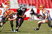 Manteca quarterback Dakarai Charles (8) tries to break Oakdale tackles during Friday Night Lights at Levi's Stadium in Santa Clara, California, on October 11, 2014. (Stan Olszewski/ Special to The Record)