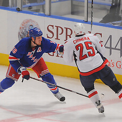 April 30, 2012: New York Rangers defenseman Marc Staal (18) lines up Washington Capitals left wing Jason Chimera (25) for a hit during third period action in Game 2 of the NHL Eastern Conference Semifinals between the Washington Capitals and New York Rangers at Madison Square Garden in New York, N.Y.