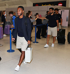 Raheem Sterling and The Manchester City team are seen arriving home after their pre-season tour of the USA.
