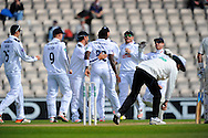 Hampshire bowler Fidel Edwards is congratulated after taking the second wicket of Warwickshire batsman Varun Chopra during the Specsavers County Champ Div 1 match between Hampshire County Cricket Club and Warwickshire County Cricket Club at the Ageas Bowl, Southampton, United Kingdom on 12 April 2016. Photo by Graham Hunt.