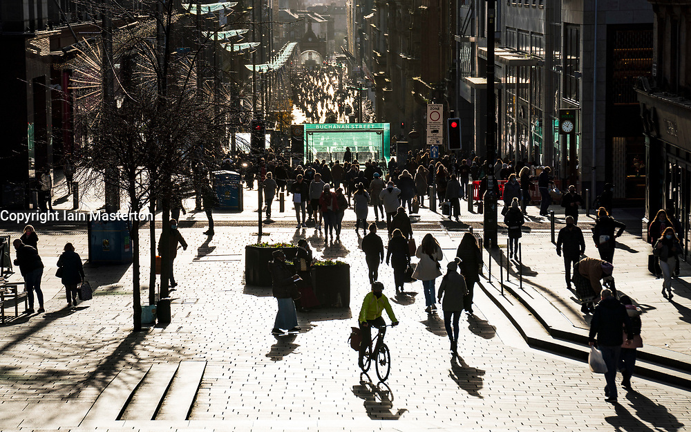 Glasgow, Scotland, UK. 19 November 2020. On the day before the highest level 4 lockdown is imposed on west and central Scotland, shops in Glasgow city centre and streets are busy with members of the public. Pictured; Crowds of shoppers in afternoon sunshine on Buchanan Street.  Iain Masterton/Alamy Live News