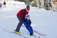 Father teaches his son to ski at Alpine Meadows, Lake Tahoe, California
