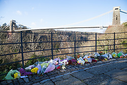 © Licensed to London News Pictures. 19/12/2014. Bristol, Avon, UK. Flowers laid out near Clifton Suspension Bridge today, 19th December 2014. The mother and daughter, Charlotte and Zaani Tiana Bevan, were found dead in Avon Gorge after leaving a St. Michael's Hospital in Bristol on 2nd December 2014. Photo credit : Rob Arnold/LNP