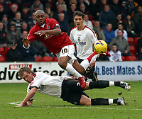 Photo: Dave Linney.<br />Walsall v Barnet. Coca Cola League 2. 24/02/2007.<br />Walsall's Hector Sam (L) flies through the air after a challenge by Simon King .