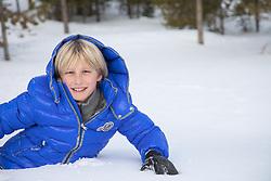 blond boy in snow