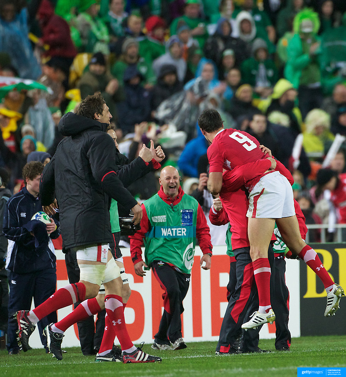 Man of the match Mike Phillips, Wales, (nine) celebrates the welsh win as the final whistle sounds during the Ireland V Wales Quarter Final match at the IRB Rugby World Cup tournament. Wellington Regional Stadium, Wellington, New Zealand, 8th October 2011. Photo Tim Clayton...