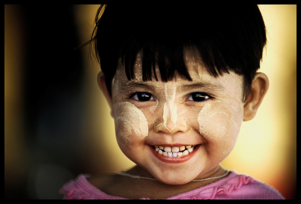 Amarapura, Myanmar (Burma) - May 2006<br /> The yellow cream on the child's face is Tanaka paste, a traditional cosmetic which is made from tree bark and used as a decorative sunscreen.<br /> Photo: Ezequiel Scagnetti