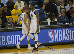 May 31, 2018 - Oakland, California, U.S - Stephen Curry #30 and Kevin Durant #35 of the Golden  State Warriors on the sidelines during  their NBA  Championship Game 1 with the Cleveland  Cavaliers at  Oracle Arena in Oakland, California on Thursday,  May 31,  2018. (Credit Image: © Prensa Internacional via ZUMA Wire)