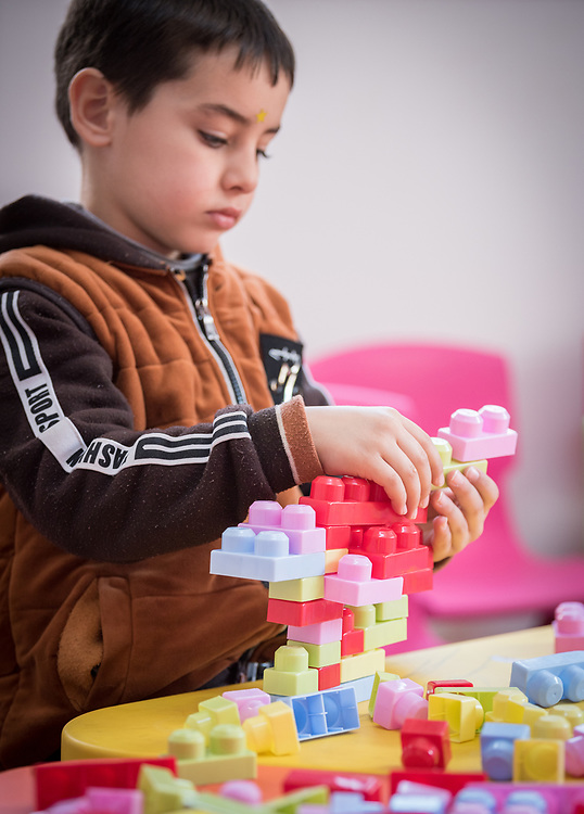17 February 2020, Zarqa, Jordan: A bot plays in 'the nanny room' at the Lutheran World Federation community centre in Zarqa. Through a variety of activities, the Lutheran World Federation community centre in Zarqa serves to offer psychosocial support and strengthen social cohesion between Syrian, Iraqi and other refugees in Jordan and their host communities.