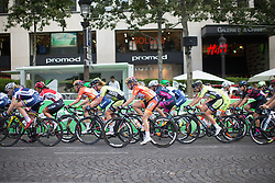 The peloton rides on the Champs Élysêes during the La Course, a 89 km road race in Paris on July 24, 2016 in France.