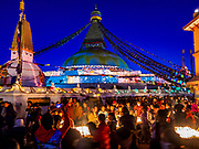 12 MARCH 2017 - KATHMANDU, NEPAL: People participate in the full moon activities at Boudhanath Stupa. Boudhanath Stupa in the Bouda section of Kathmandu, is one of the most revered and oldest Buddhist stupas in Nepal. The area has emerged as the center of the Tibetan refugee community in Kathmandu. On full moon nights thousands of Nepali and Tibetan Buddhists come to the stupa and participate in processions around the stupa. The stupa was heavily damaged in the earthquake of 25 April 2015 but has been repaired with the financial assistance of global Buddhist organizations.       PHOTO BY JACK KURTZ