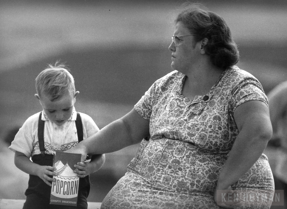 In Pittsburgh, mother doesn't care as she takes the child's popcorn.
